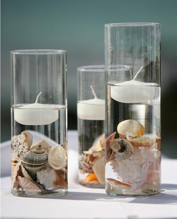 Centros de mesa feitos com motivos marinhos, conchas