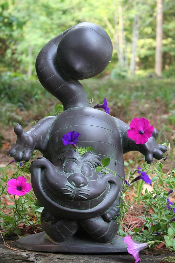 Esculturas para jardim que impressionam - o famoso gato que ri
