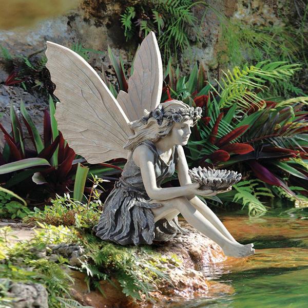 Esculturas para jardim que impressionam - fada