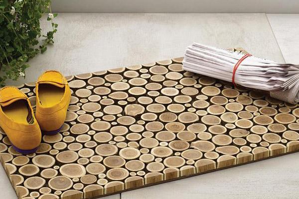 10 tapetes de entrada para sua casa - Com troncos de madeira